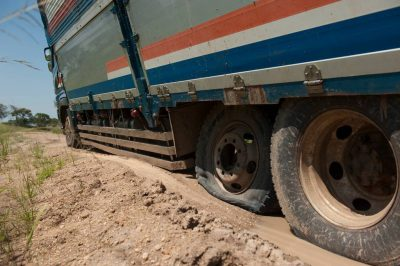 Photo: A large truck stuck on the side of the road due to a flat tire in Uganda, Africa.