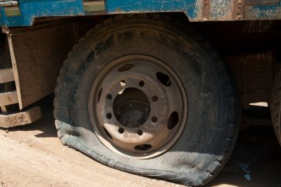 Photo: A truck stuck on the side of the road due to a flat tire in Uganda, Africa.