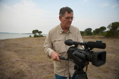 Photo: A videographer in Queen Elizabeth National Park in Uganda, Africa.