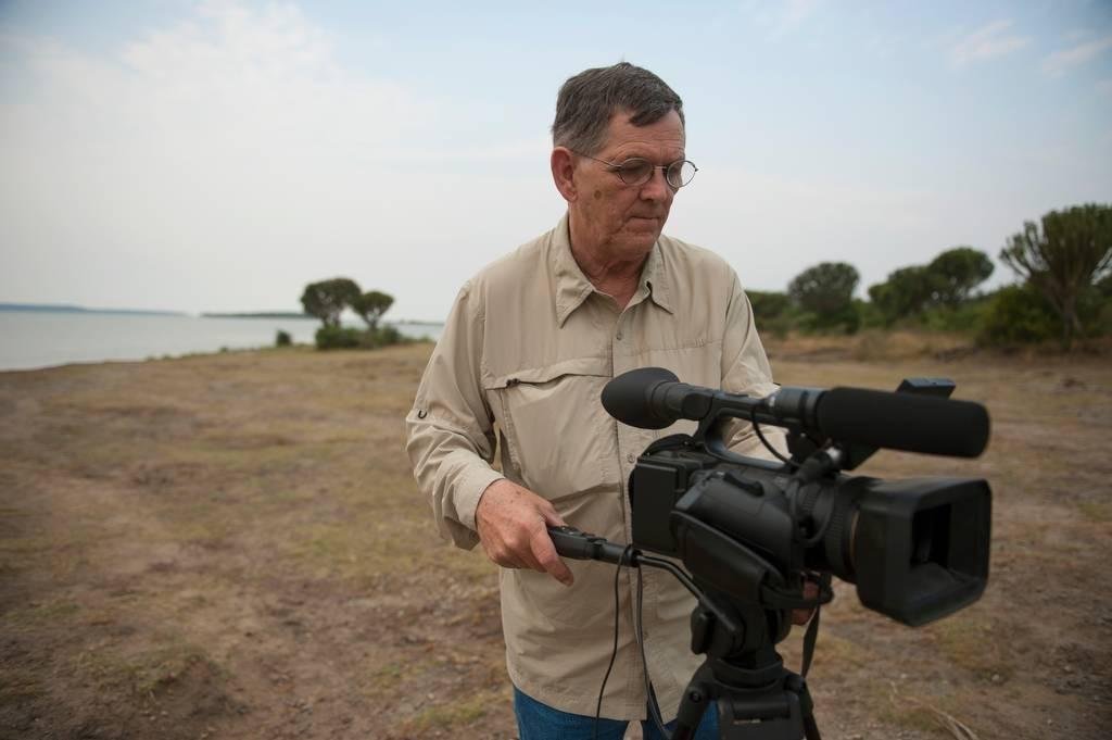Photo: A videographer in Queen Elizabeth National Park in Uganda, Africa.