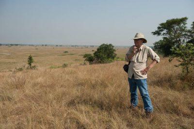 Photo: A man admires the scenery in Queen Elizabeth National Park in Uganda, Africa.