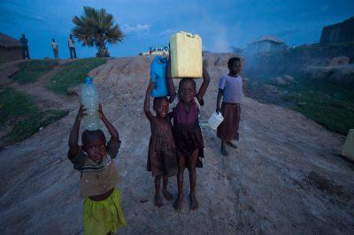 Photo: Locals haul water from Lake Albert.
