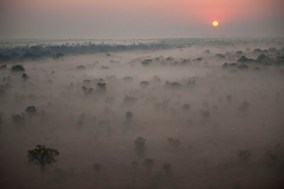 Photo: Aerials of smoke, fog and slash and burn agriculture, both by the mountain and in the main park of Gorongosa National Park in Mozambique, Africa.