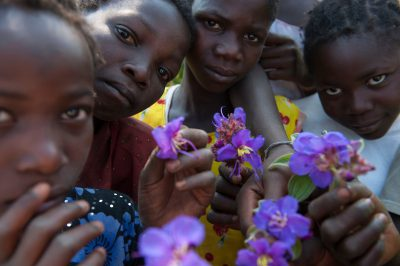 Photo: Dozens of children pick flowers from the genus Dissotis during the bioblitz in Gorongosa National Park, Mozambique, Africa.