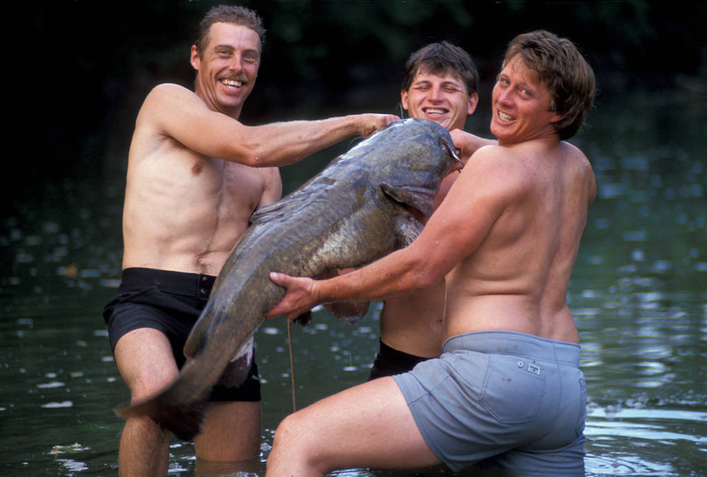 Photo: Catfish noodling on the Kansas/Oklahoma border.