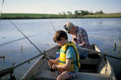 Photo: A boy and his grandfather go fishing in a Nebraska pond.