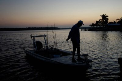 Photo: A fisherman and his boat in the 10,000 Islands area of Florida's Everglades National Park, near Naples, FL.