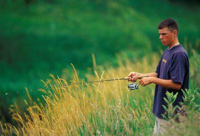 Photo: A young man fishing in Nebraska.