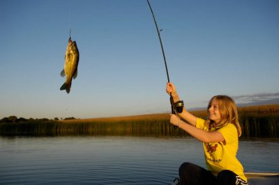 Photo: A 10-year-old fishes on the Snyder pond near Bennet.