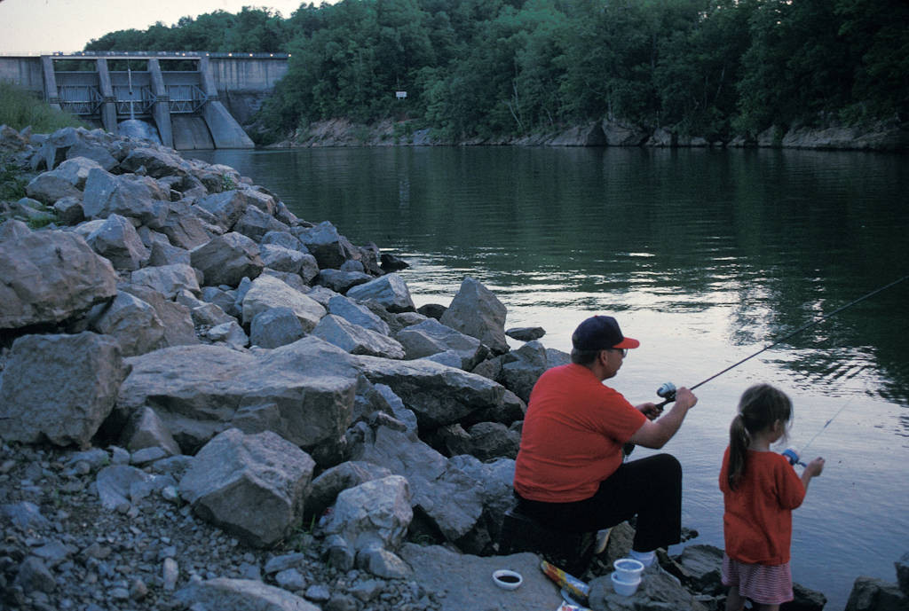 Photo: A young girl fishes with her father near Tellico Dam in Lenoir City, Tennessee.