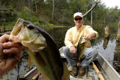 Photo: A man shows the bass he caught while fishing on a strip mining pit in Southeast KS.