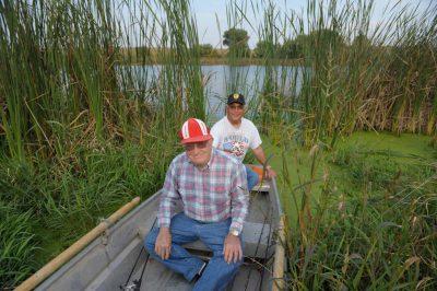 Photo: Two senior men fish on a Nebraska farm pond.