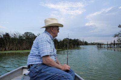 Photo: A senior man goes catch-and-release fishing on a Nebraska farm pond.