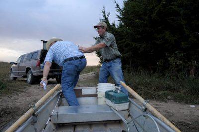 Photo: A senior man and his son go fishing on a Nebraska farm pond.