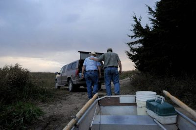 Photo: A senior man and his son go fishing on a Nebraska farm pond.