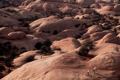 Photo: Mountain bikers on Slickrock Trail on BLM land near Moab, Utah.