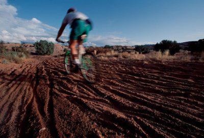 Photo: Mountain biker on Slickrock Trail on BLM land near Moab, Utah.