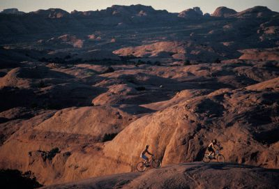Photo: Mountain bikers on Slickrock Trail on BLM land near Moab, Utah.