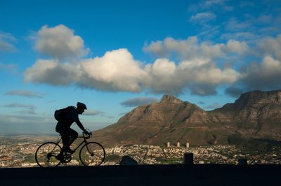 Photo: A cyclist on Signal Hill overlooking Cape Town, South Africa.