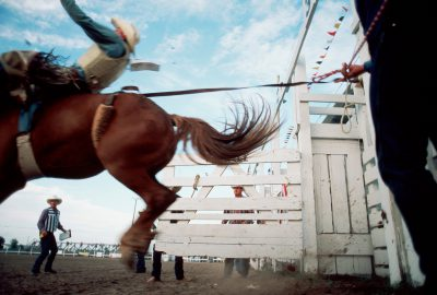 Photo: A bronco rider tries his best to make eight seconds at Nebraska's Big Rodeo in Burwell.