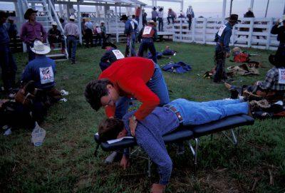 Photo: Chiropractors work behind the scenes re-aligning the jostled skeletons of cowboys at Nebraska's Big Rodeo in Burwell.