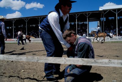 Photo: Ron Jurgenson, a contestant at Nebraska's Burwell Rodeo, is comforted by Dale Siedel after dislocating his shoulder during an event.