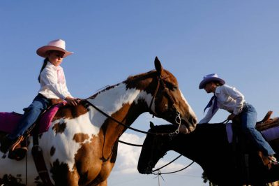 Photo: Two young cowgirls at Nebraska's Big Rodeo in Burwell.