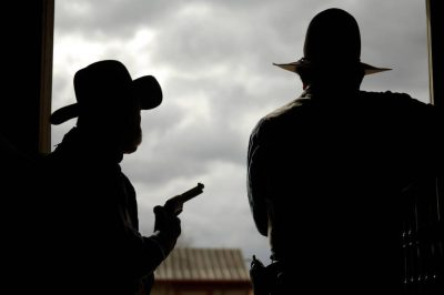 Photo: Two cowboys in silhouette at the Eaves Movie Ranch near Santa Fe.