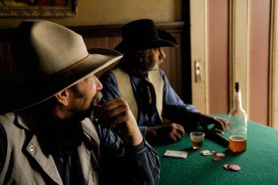 Photo: Two cowboys play cards at the Eaves Movie Ranch near Santa Fe.