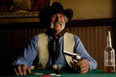 Photo: A cowboy play cards at the Eaves Movie Ranch near Santa Fe.