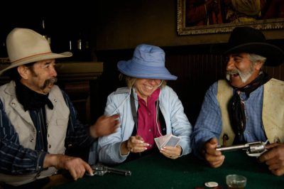 Photo: Two cowboys play cards with a tourist at the Eaves Movie Ranch near Santa Fe.