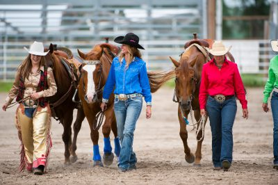 Photo: Rodeo queens leading their horses.