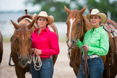 Photo: Two rodeo queens stand with their horses.