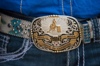 Photo: A detail shot of a rodeo queen's belt buckle.