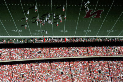 Photo: A reflection in the press-box window provides an unusual view of Memorial Stadium, home of the Univeristy of Nebraska Cornhuskers.