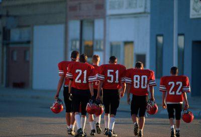 Photo: A six-man football team walks down the main street in Bradshaw, Nebraska.