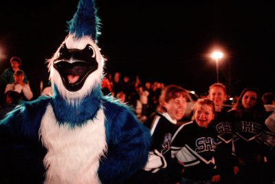 Photo: The Spalding High School mascot entertains the crowd and the cheerleaders at a six-man football game.
