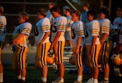 Photo: The Trumbull, Nebraska Bearcats line up before a game of six-man football against the Chester-Hubbell-Byron Bulldogs in Chester, NE, the birthplace of six-man football.
