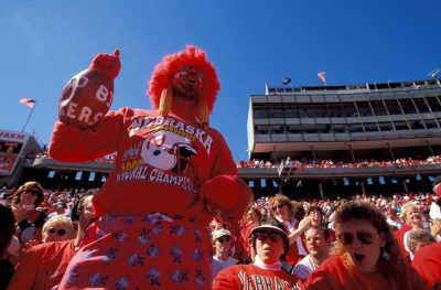 Photo: Cornhusker football fans fill Memorial Stadium at the University of Nebraska-Lincoln, expressing their enthusiasm in a variety of ways.