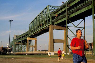 Photo: Bostonians play softball underneath the Tobin Bridge.
