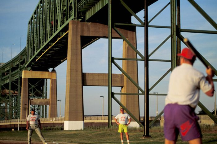 Photo: Bostonians play softball underneath the Tobin Bridge.