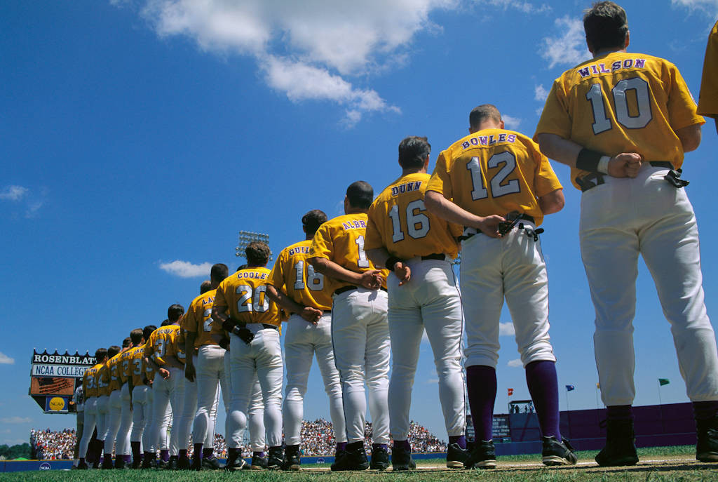 Photo: Players line up for the national anthem at the College World Series (baseball) at Rosenblatt Stadium in Omaha, Nebraska.