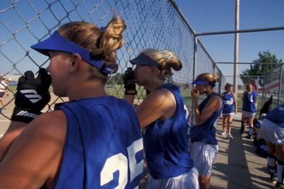 Photo: Teammates watch a softball game in Lincoln, Nebraska.