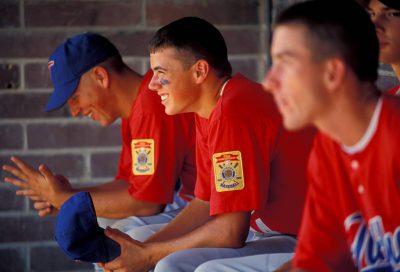Photo: Teammates watch a baseball game in Nebraska.