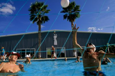 "Photo: Retirees frolic in a pool at the Fun N Sun Resort in San Benito, one of many border communities that attract ""winter Texans"" from the north every fall."