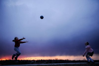 Photo: Two young girls practice their soccer skills atop Holmes Lake Dam in Lincoln, NE.