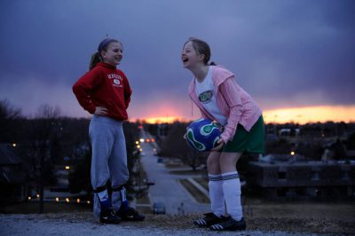 Photo: Two young girls chat after practicing soccer atop Holmes Lake Dam in Lincoln, NE.