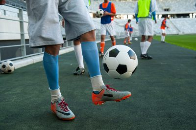 Photo: A man kicks a soccer ball in Cape Town, South Africa.