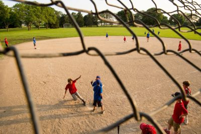 Photo: An elementary aged boy slides home during a t-ball game.