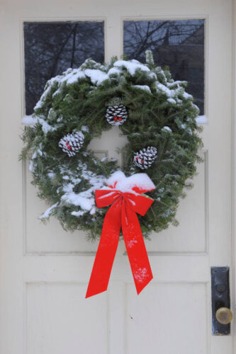 Photo: A Christmas wreath on the front door of a house.